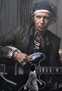 A man walks past a billboard advertisement of Keith Richards outside the Louis Vuitton store on New Bond Street, in London, U.K., on Tuesday, March 4, 2008. The ad follows an earlier one in the series for Louis Vuitton by Annie Leibovitz, featuring Mikhail Gorbachev. Photographer: Chris Ratcliffe/Bloomberg News